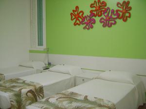 A bed or beds in a room at Coqueiros Express Hotel