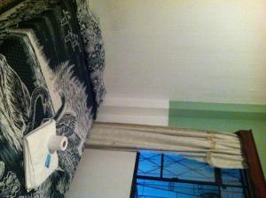 A bed or beds in a room at Hotel El Portal