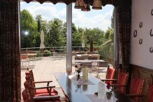 Ein Restaurant oder anderes Speiselokal in der Unterkunft Hotel Restaurant Siegblick