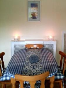 A bed or beds in a room at Bluebell Cottage Waterfall House