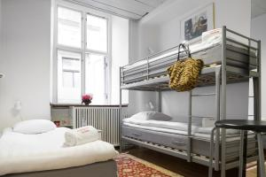 A bunk bed or bunk beds in a room at Archipelago Hostel Old Town