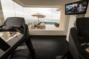 The fitness center and/or fitness facilities at Renuka City Hotel