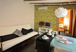 Een zitgedeelte bij Apartaments Ciutat Vella