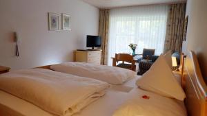 Ein Bett oder Betten in einem Zimmer der Unterkunft Sonnleiten-Rupert