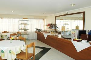 A restaurant or other place to eat at Omiros Hotel