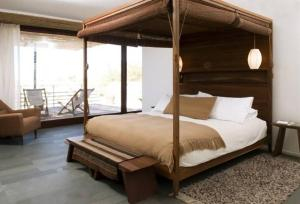A bed or beds in a room at Tierra Atacama Hotel & Spa