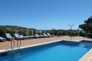 The swimming pool at or near Hotel Port-Lligat