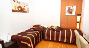 Ein Bett oder Betten in einem Zimmer der Unterkunft Taurus 4