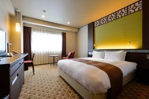 A bed or beds in a room at JR Kyushu Hotel Nagasaki