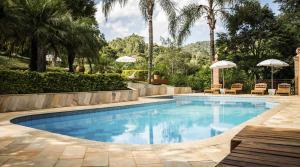 A piscina localizada em Pousada Villa Campestre ou nos arredores