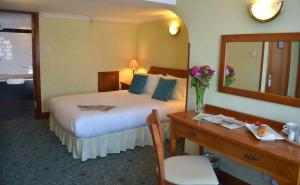 A bed or beds in a room at The Ayrshire and Galloway