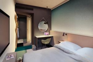 Un ou plusieurs lits dans un hébergement de l'établissement Comfort Hotel Xpress Central Station