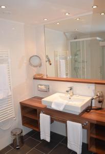 Ein Badezimmer in der Unterkunft Hotel-Restaurant Häupl