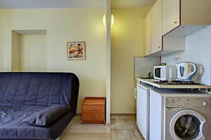 Кухня или мини-кухня в STN ApartHotel on Grafsky