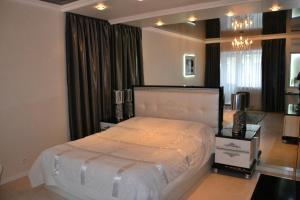 Кровать или кровати в номере Home Lux Apartments у Кремля