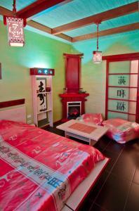 Кровать или кровати в номере Отель Дискавери