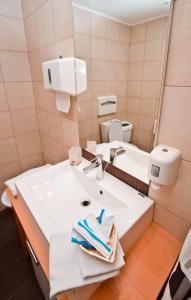 Ванная комната в Отель Дискавери