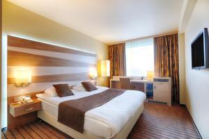Кровать или кровати в номере Русотель