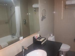 A bathroom at Best Western Premier The Hive