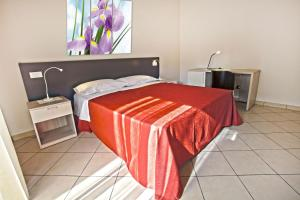 A bed or beds in a room at Il Fiore in una Stanza