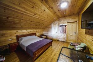 Кровать или кровати в номере Гостинично-ресторанный комплекс Подворье