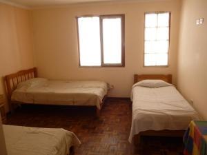 Una habitación en Casa de Huespedes San Marcos