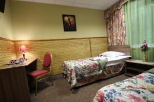 Кровать или кровати в номере Отель «Натали на Среднемосковской 7»