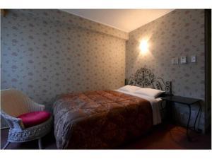 Ein Bett oder Betten in einem Zimmer der Unterkunft Sakura Fleur Aoyama