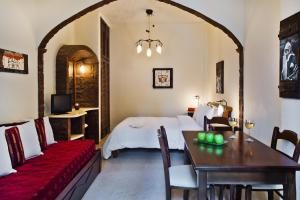 Un ou plusieurs lits dans un hébergement de l'établissement Galatia Villas