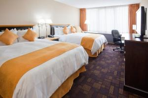 A bed or beds in a room at Radisson Hotel Milwaukee West
