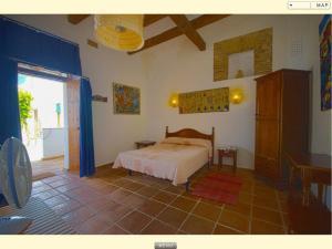 A bed or beds in a room at El Palomar de la Breña