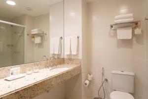 Um banheiro em Mercure Salvador Pituba
