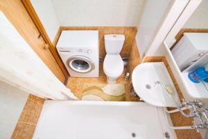 Ванная комната в Busines Brusnika Apartment Tyoply Stan