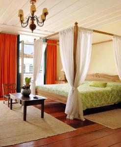 A bed or beds in a room at Hotel Villa Bahia