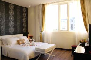 Ein Bett oder Betten in einem Zimmer der Unterkunft Orchid Hotel