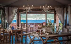 A restaurant or other place to eat at Villa del Golfo Lifestyle Resort