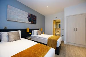 A bed or beds in a room at Staycity Aparthotels Greenwich High Road