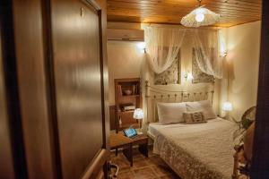A bed or beds in a room at Oriades