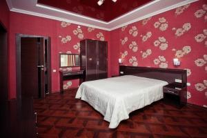Кровать или кровати в номере Отель Невский