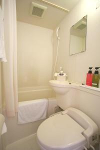 A bathroom at Hotel Abest Kochi