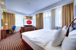Кровать или кровати в номере Апарт-Отель Южный