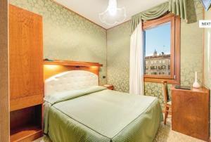Un ou plusieurs lits dans un hébergement de l'établissement Atlantide Hotel