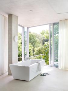 A bathroom at H-House Architectural Residence