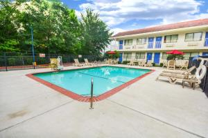The swimming pool at or near Motel 6-Huntsville, TX