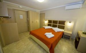 Ένα ή περισσότερα κρεβάτια σε δωμάτιο στο Gaia Studios & Apartments