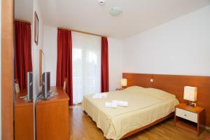 Ein Bett oder Betten in einem Zimmer der Unterkunft Hotel Villa Daniela