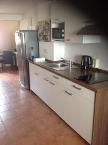 A kitchen or kitchenette at Pension Webstuhl
