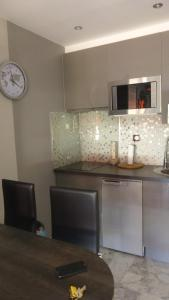 A kitchen or kitchenette at One Bedroom Lacour 249