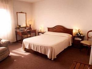 Letto o letti in una camera di Albergo San Lorenzo