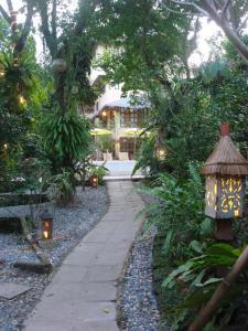 A garden outside Sun Villa Hilltop Resort & Spa
